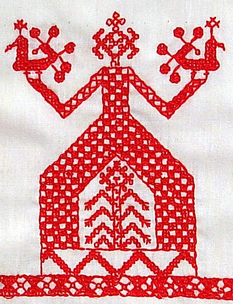 нитями вышивки видно белое